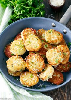 Served with a yogurt or sour cream sauce, these crispy potato and parmesan bites are a fun appetizer made with mashed potatoes, a favorite winter comfort food.