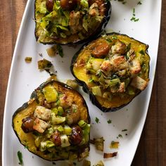 Baked Acorn Squash with Chestnuts, Apples and Leeks | Halved acorn squash make perfect single-serving bowls. These make a great vegetarian main course for any winter holiday, but they're also a festive accompaniment to turkey, ham or roast goose.
