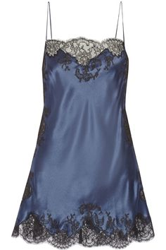 Carine Gilson midnight blue chemise for under darker blouses. I prefer a chemise to a camisole for work where I am so active. It does not come untucked.