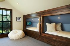 Beds built in to the knee-wall. Perfect bed design for bedrooms with a sloping roof -  from Decoist.com