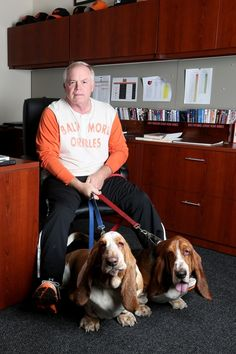 Buck Showalter with his bassett hounds. Baltimore Orioles Baseball, Baltimore Ravens, Buck Showalter, Dog Calendar, Hometown Heroes, Bassett Hound, Drag, Dog Rules, Sports Fan Shop