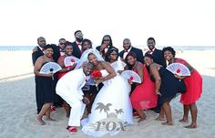 Barefoot bridesmaids with stylish groomsmen and fans on the Ocean City Maryland beach - wedding portrait by Rox Beach Weddings:  https://www.roxbeachweddings.com/