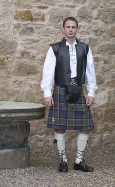 The Balmoral Kilt, Traditional 8 Yard Kilt with Flashes in a  more informal, historic look with the rugged Jacobite Swordsman outfit (MacDonald of Clanranald Muted tartan)