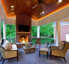 It's time to get your outdoor living area ready for warmer weather! Tap the link in our bio for more photos of this covered porch complete with a wood burning fireplace. (Project by #PorchPro Home Repair Team)