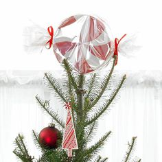 This yummy tree topper makes for a sweet Christmas decoration. The fun red-and-white pattern will fit in with any decorating theme. Make your own peppermint tree topper. Diy Christmas Mantel, Pretty Christmas Trees, Christmas Tree Themes, Holiday Tree, Christmas Tree Toppers, Holiday Crafts, Christmas Holidays, Christmas Ornaments, Christmas Wishes