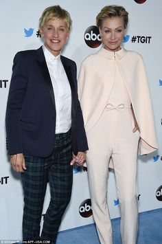 Holding on tight: Ellen Degeneres, 56, and wife Portia de Rossi, 41, were looking as happy as ever while at a Hollywood event Saturday evening. The couple posed hand-in-hand while strolling down the red carpet