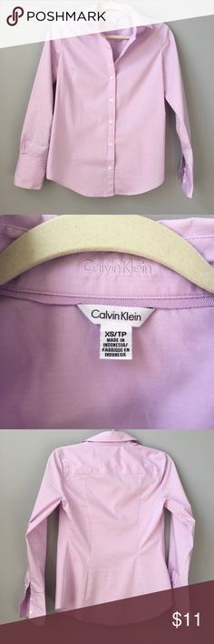 Calvin Klein purple/lilac dress shirt Calvin Klein x-small dress shirt. Purple/lilac color. Has three button on sleeves, worn twice on interviews. Calvin Klein Tops Button Down Shirts