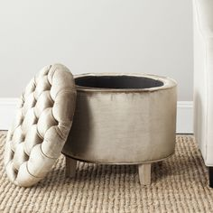 The quintessential storage ottoman, Amelia is transitional in design with button tufted removable quilted top and oak legs with pretty pickled oak finish.
