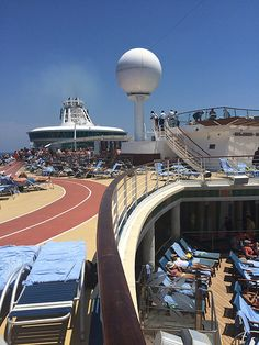 Best way to tan on Liberty of the Seas: head straight to the pool deck to claim a lounge chair with a view. The towels are waiting!