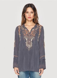 Ross Tunic The Johnny Was ROSS TUNIC is the ultimate boho tunic top! A feminine floral embroidery design details the ROSS TUNIC's front, continuing onto the back and sleeves. Layer this boho embroidered tunic over a silk maxi dress, or pair it with linen pants and a beaded Obi belt! - Rayon Georgette - Five Button Henley Front, Mandarin Collar, Long Sleeves - Signature Embroidery - Care Instructions: Machine Wash Cold, Tumble Dry Low