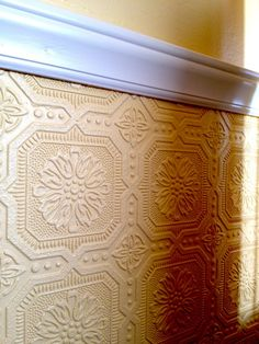 The textured paintable wallpaper I'm using beneath our chair-rail