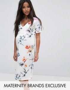 0b1ea690af1 Bluebelle Maternity Wrap Frilled Hem Dress in Floral - Multi. Maternity