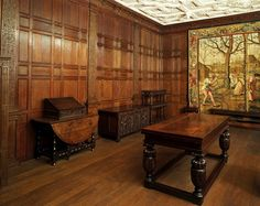 The Jacobean 'Old Palace' at Bromley-by-Bow. The panelling  and the frieze that encircles the room at ceiling height are decorated with strapwork ornament.  The four caryatids from engravings entitled Caryatidae by the Netherlandish designer Hans Vredeman de Vries (1527-1606). Below them, two figures in niches represent Peace and Plenty. Victoria and Albert Museum