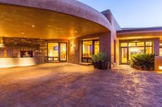 The pueblo inspired architecture and floor plan was superbly designed and includes natural custom materials creating a true adobe masterpiece. The interior connects with the outdoors through a central courtyard while showcasing rounded corners, stepped levels and massive timber beams stretching across the ceiling.