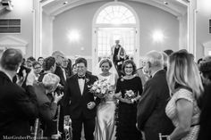 Jess comes down the aisle with both of her parents. wedding at The Philadelphia Cricket Club