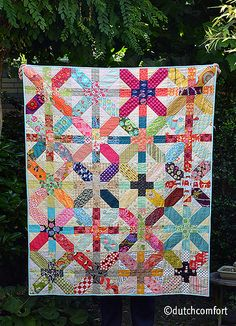 do. Good stitches, Comfort Circle, Japanese Plus and X quilt | Flickr - Photo Sharing!  This is a great way to use up scraps of awesome color.