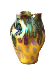 Loetz was an Austrian glass house working in the early 20th century, and their work was inspired by Tiffany's iridescent glass, but they developed their own techniques and forms. This Art Nouveau vase has beautiful form and decoration, Austria, c 1900.