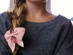 Great idea with skinny jeans, flats, a throw over sweater, the pretty side braid with a light pink bow will make your outfit pop.