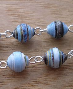 Pretty Blue Paper bead necklace, via Flickr.