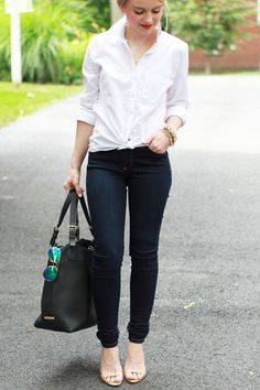 Blogger Poor Little It Girl styles a classic white Gap button-down with skinny jeans and heels.
