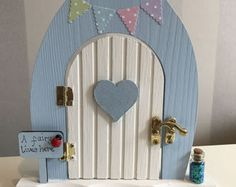 hand-painted and hand-decorated fairy and elf doors by TheLittlehCompany Door Crafts, Wooden Crafts, Fairy Garden Houses, Fairy Gardens, Fairies Garden, Tooth Fairy Doors, Elf Door, Fairy Pictures, Shaped Cards