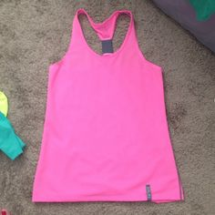Underarmour running top Mesh. Like new. Size small but can fit a medium. Loose fit. Under Armour Tops Tank Tops