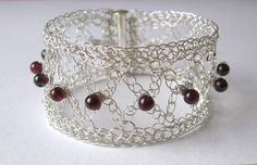 Silver wire crochet bracelet, beaded cuff bracelet handmade from silver plated copper wire, decorated with 10 dark red garnet gemstone beads