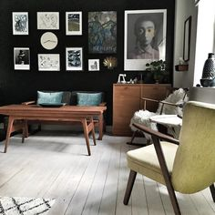 my scandinavian home: A Striking Mid-Century Inspired Danish Home with a black accent wall / gallery wall - Fraubitte.