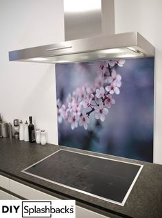 Blossom printed glass splashback. Shop from over 400 designs, or provide your own. All of our splashbacks are: Heat Resistant to 200 degrees, toughened safety glass, available in any size, and all come with a seven year warranty. Visit diysplashbacks.co.uk to discover more.
