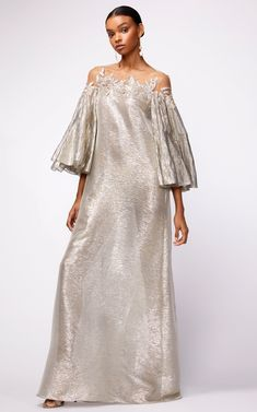 Shop Off Shoulder Metallic Full Sleeve Caftan. Oscar de la Renta's 'Off Shoulder Metallic Full Sleeve Caftan' is designed with a floor length straight silhouette, off shoulder, embroidered straight neckline, with draped full sleeves. Abaya Fashion, Fashion Line, Fashion Dresses, African Attire, African Dress, Elegant Dresses, Beautiful Dresses, Kaftan Designs, Mother Of The Bride Dresses Long