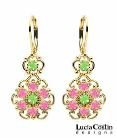 European Glamour Lucia Costin Lever Back Flower Dangle Earrings Made of 14K Yellow Gold over .925 Sterling Silver with Pink and Light Green Swarovski Crystals and Dots; Handmade in USA Lucia Costin. $54.00. Floral Dangle earrings amazingly designed by Lucia Costin. Update your everyday style with inspiration when wearing this piece of jewelry. Beautifully designed with rose and peridot Swarovski crystals. Flowers and fancy ornaments beautifully combined. Unique jewel...