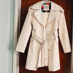 An original Milly of New York trench coat An original Milly of New York white cream trench coat. Looks like new *** very small light grey speckles on one sleeve. Not noticeable Milly Jackets & Coats Trench Coats