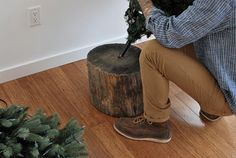Natural stand for fake Christmas tree......what a great idea Found via Shelterness