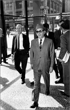"""Sam Giancana, organized crime boss known as """"Momo,"""" walks into a federal building in Chicago, Ill., May 19, 1965."""