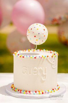 A simple but cute smash cake! | Rainbow Sprinkles & Confetti First Birthday Party! | DessertedPlanet.com