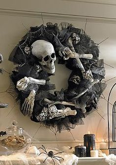 Perfect above your mantle or on your front door, the Bony Wreath add haunting character to your home with it's spooky bones and abundant black tulle.