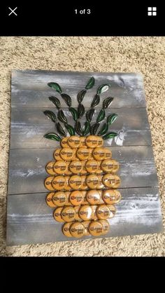 Rustic Bottle cap Pineapple wall art decor This is a handmade pineapple made from yellow and green bottle caps. Boards are antiqued black and white as pictured, approximately 14 Diy Bottle Cap Crafts, Beer Cap Crafts, Bottle Cap Projects, Wine Cork Crafts, Beer Cap Art, Beer Bottle Caps, Bottle Cap Art, Beer Caps, Bottle Cap Table