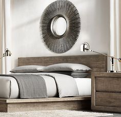 This vintage-inspired wood sunburst mirror from Restoration Hardware is the perfect piece to hang above your bed.