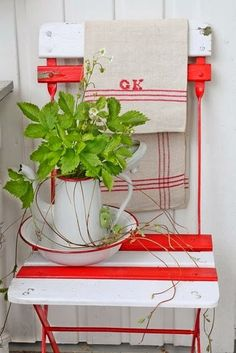 red and white slat chair with enamelware