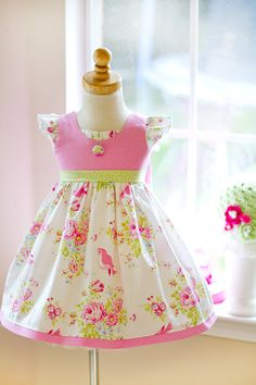 New in 2016. Our Zoey's Garden Flutter dress is the perfect summer dress for your little girl. This gorgeous 100% cotton print is adorned with birds and pink