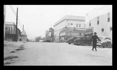 A winter day in 1941, looking west toward the corner of Main and Spring, showing Dr. Alex van Ravenswaay crossing from his hospital toward the old Post Office.  At right is Mattingly's 5 & 10 cent store, with J.C. Penney's across Main Street; beyond that are the Rehmeier Photo Studio just before the old police and fire department building next to the Methodist Church.  A sign next to the Kemper State Bank urges citizens to buy War Bonds; Cooper County Bond sales had already totalled $72,800. Main Street, Street View, St Louis County, Old Post Office, Historical Images, Winter Day, Fire Department, Photo Studio, Family History