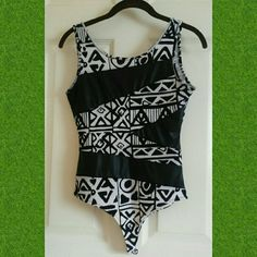 Thong bodysuit! Aztec patterned black and white thong body suit as pleather leather and cotton fabric and worn TWICE ( has light deodorant stain on arms area picture of it shown above) Tic toc Tops