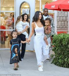 Family:Kim Kardashian star wore a white tank top with grey sweats while heading to Ruby's restaurant in LAfor North West's fourth birthday party; pictured with husband Kanye West, their son Saint, sister Kourtney Kardashian and her kids