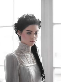 This is an example of the Edwardian collar style. The Edwardian collar style is the most modest because it covers the neck and below.