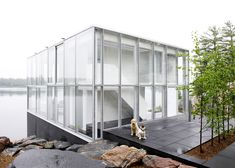 The photographer's studio over a boathouse on Stoney Lake is a glass pavilion on the edge of a lake in Ontario, Canada. This studio house was designed by Modern Glass House, Glass House Design, Modern House Design, Home Design, Interior Design, Design Ideas, Glass Cube, Glass Boxes, Residential Architecture