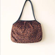 Vintage Leopard Print Bag Perfect condition. Vintage leopard print bag from a consignment shop in Lake Worth Florida. Never used. Faux leopard print fur. Black leather detailing & straps. Bags Shoulder Bags