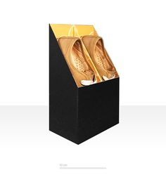 Construction & design of packaging for shoes and secondary uses for wine waiter.