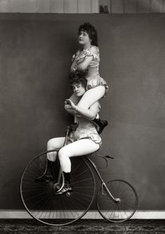 April 20, 1891: Victorian trick cyclists performing a balancing act.