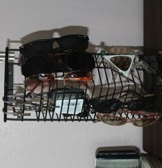 re-purposed CD rack into sunglasses and key holder