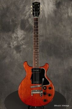 Gibson Double Cut Les Paul Special 1959 Cherry w Maestro Vibrola Big fan of the double cut les paul style guitars- sweet and simple Acoustic Guitar Art, Guitar Amp, Cool Guitar, Gibson Electric Guitar, Gibson Guitars, Electric Guitars, Les Paul Jr, Instruments, Guitar Logo